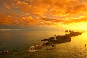Fotos Sonnenaufgänge und Sonnenuntergänge Insel Leuchtturm Himmel Nassau Bahamas