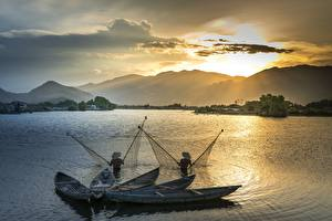 Photo Sunrises and sunsets Mountain Asiatic Boats Fishing Two Hat Nature