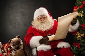 Images Teddy bear Santa Claus Gifts Winter hat Glasses Beard Sitting