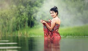 Pictures Water Asian Grass Brunette girl Staring Girls