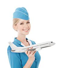 Fotos Flugzeuge Weißer hintergrund Blond Mädchen Flugbegleiter Lächeln Blick Mädchens