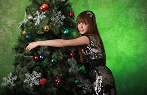 Pictures New year New Year tree Snowflakes Balls Brown haired Smile Girls