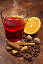 Pictures Drinks Cinnamon Orange fruit Nuts Highball glass Food