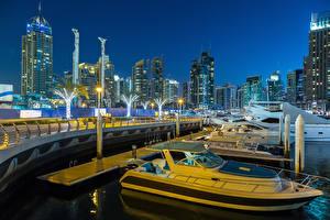 Bakgrunnsbilder Dubai De forente arabiske emirater Hus Skyskrapere Broer Kveld Passbåt Gatelykter Byer