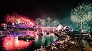 Photo Fireworks Bridges Australia Night time Sydney Bay Cities