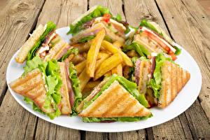 Fotos Pommes frites Sandwich Bretter Teller Lebensmittel