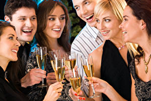 Pictures Holidays Champagne Man Laughter Stemware Blonde girl Joy Girls