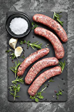 Photo Meat products Sausage Allium sativum Black pepper Cutting board Salt Food