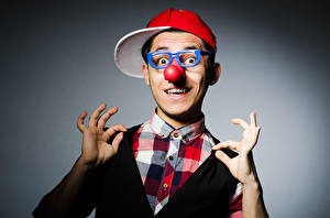 Picture Man Gray background Clown Baseball cap Eyeglasses Nose Hands