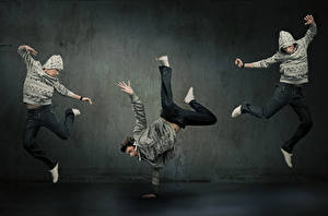 Image Men Three 3 Dance Jump Hands Legs