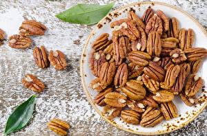 Hintergrundbilder Nussfrüchte Großansicht Teller Lebensmittel