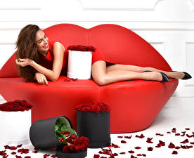 Pictures Roses Brown haired Couch Smile Petals Red Girls