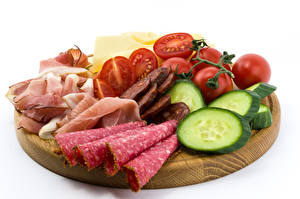 Photo Sausage Ham Tomatoes Cucumbers Cutting board Sliced food