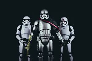 Photo Star Wars - Movies Soldiers Toys Three 3 Black background Armour Helmet