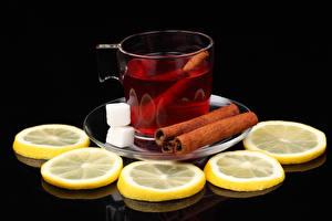 Bilder Tee Zitrone Zimt Schwarzer Hintergrund Tasse Zucker Lebensmittel