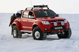 Bilder Toyota Pick-up Rot Metallisch 2007 Arctic Trucks Hilux Invincible AT38 Autos