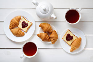 Image Valentine's Day Kettle Tea Croissant Butterbrot Wood planks Breakfast Plate Cup Heart Food