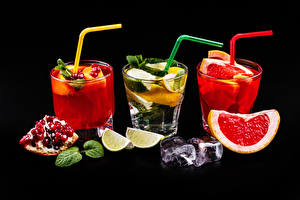 Images Alcoholic drink Cocktail Pomegranate Grapefruit Lime Black background Three 3 Highball glass Ice Food