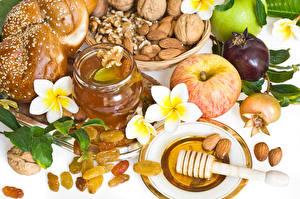 Fotos Äpfel Honig Frangipani Nussfrüchte Rosinen
