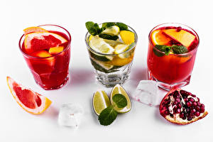 Image Mixed drink Alcoholic drink Grapefruit Lime Pomegranate White background Shot glass Ice Food