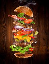 Bilder Fast food Burger Brötchen Gemüse Fleischwaren das Essen