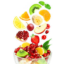 Image Fruit Pomegranate Bananas Kiwi Strawberry White background Grain Food