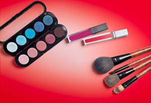 Pictures Cosmetics Red background Makeup Paintbrush