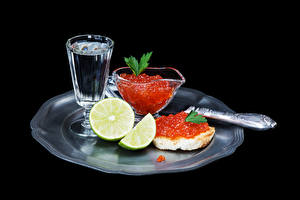 Picture Seafoods Caviar Butterbrot Vodka Lime Black background Shot glass