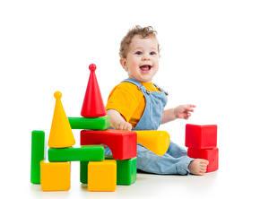 Bilder Spielzeuge Weißer hintergrund Baby Glücklich