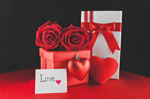 Pictures Valentine's Day Roses Black background English Present Box Red Heart Bow Flowers