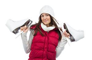 Bilder Weißer hintergrund Braune Haare Mütze Schlittschuh Hand junge frau Sport