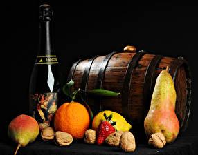 Photo Cask Wine Fruit Nuts Orange fruit Pears Black background Bottles