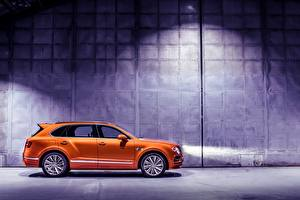 Fotos Bentley Seitlich Orange Crossover Bentayga automobil