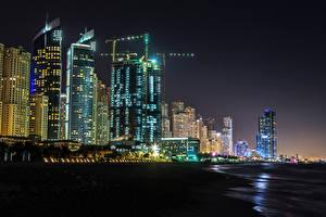 Bakgrunnsbilder De forente arabiske emirater Dubai Bygninger Skyskrapere Natt Byer