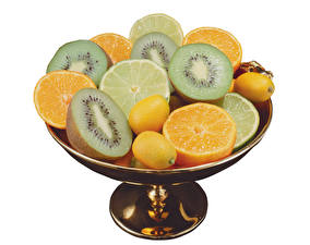 Photo Fruit Kiwi Orange fruit Lemons White background Food