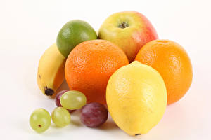 Pictures Fruit Lemons Orange fruit Grapes White background Food