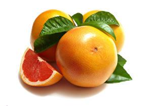 Picture Grapefruit Closeup White background Pieces Leaf Food