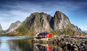 Bilder Norwegen Lofoten Küste Gebäude Felsen Bucht