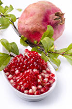 Images Pomegranate White background Grain Branches Food