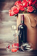 Bilder Rosen Wein Kerzen Flasche Weinglas Lebensmittel Blumen