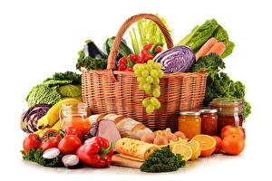 Photo Vegetables Fruit Pepper Tomatoes Cheese Citrus Ham Bread White background Wicker basket Jar Eggs Food