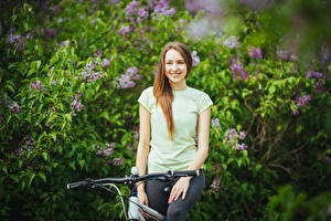 Pictures Bicycle handlebar Brown haired Smile Staring Girls