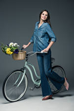 Wallpapers Bouquets Gray background Brown haired Smile Bicycle Jeans Formal shirt Wicker basket Girls
