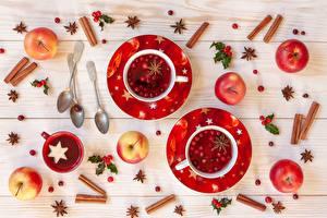 Fotos Neujahr Zimt Äpfel Tasse Löffel Untertasse Lebensmittel