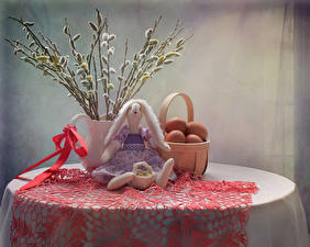 Picture Easter Still-life Table Branches Wicker basket Eggs Doll Bow knot Food