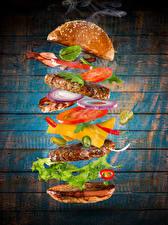 Bilder Fast food Burger Brötchen Fleischwaren Gemüse Bretter das Essen
