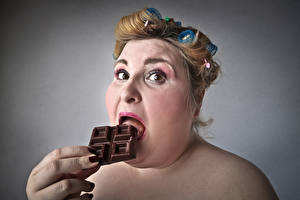 Pictures Fingers Chocolate Gray background Brown haired Fat Face Girls