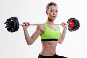 Pictures Fitness Barbell Glance Hands White background Girls Sport