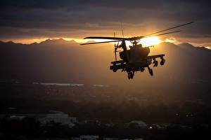 Pictures Helicopters Sunrises and sunsets AH-64 Apache US American