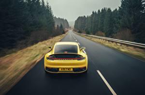 Wallpapers Porsche Roads Yellow Back view Motion 911 Carrera 4S 2019 automobile